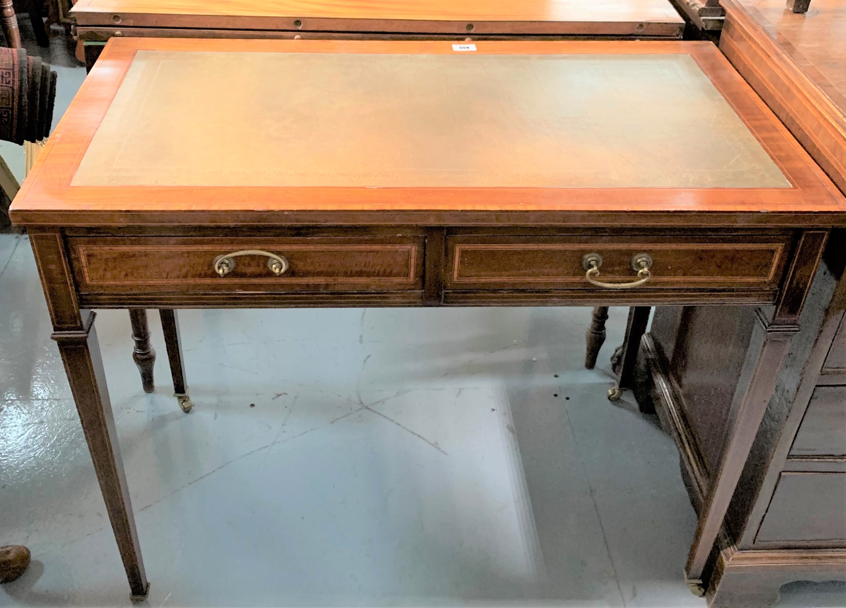 """Cross banded inlaid desk on castors with leather top and 2 drawers. 28.5"""" high, 36"""" wide, 19"""" deep"""