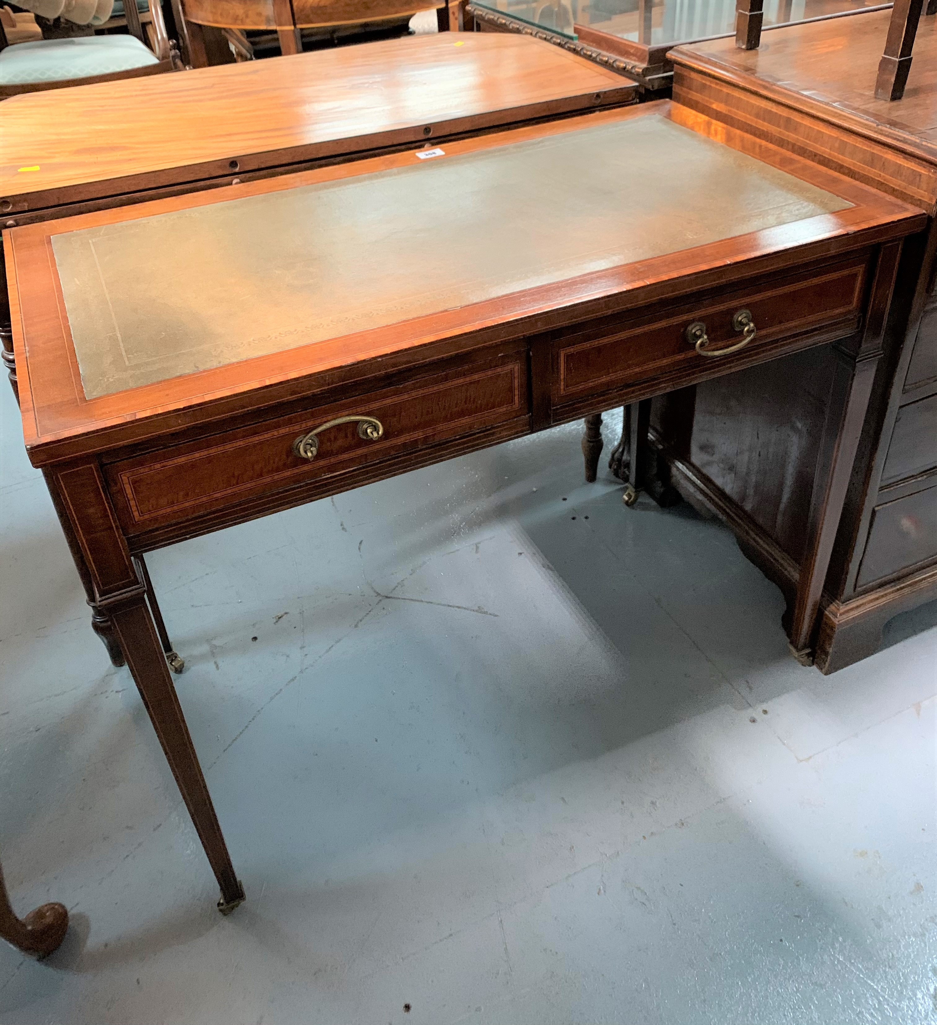 """Cross banded inlaid desk on castors with leather top and 2 drawers. 28.5"""" high, 36"""" wide, 19"""" deep - Image 2 of 5"""