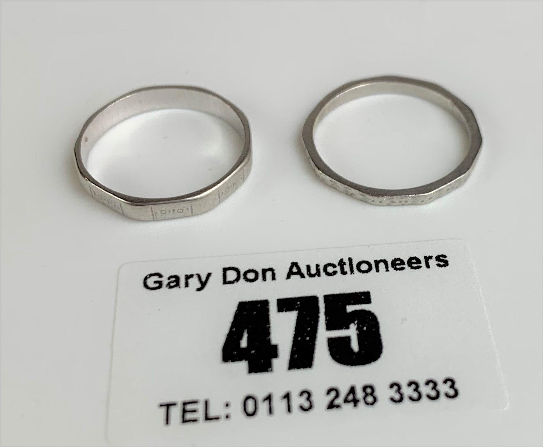 2 platinum wedding bands, sizes L and M, total w: 4.8 gms