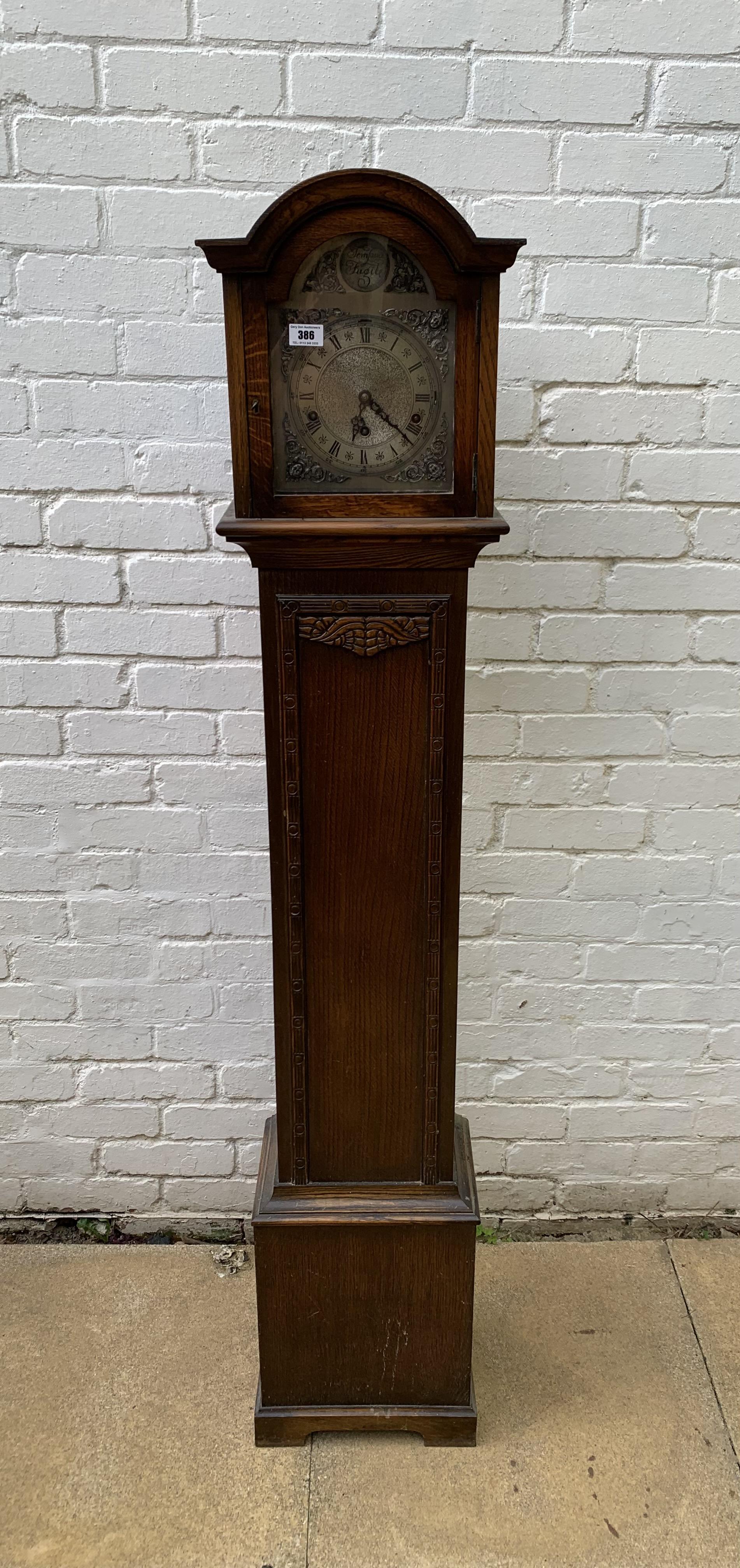 "Oak longcase grandmother clock with brass face, pendulum, key and single weight. Not working. 64"""