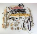Large bag of assorted dress jewellery including necklaces, beads, earrings, brooches etc.