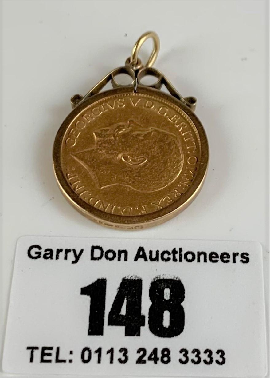 1928 full sovereign in 9k holder, total w: 9.6 gms