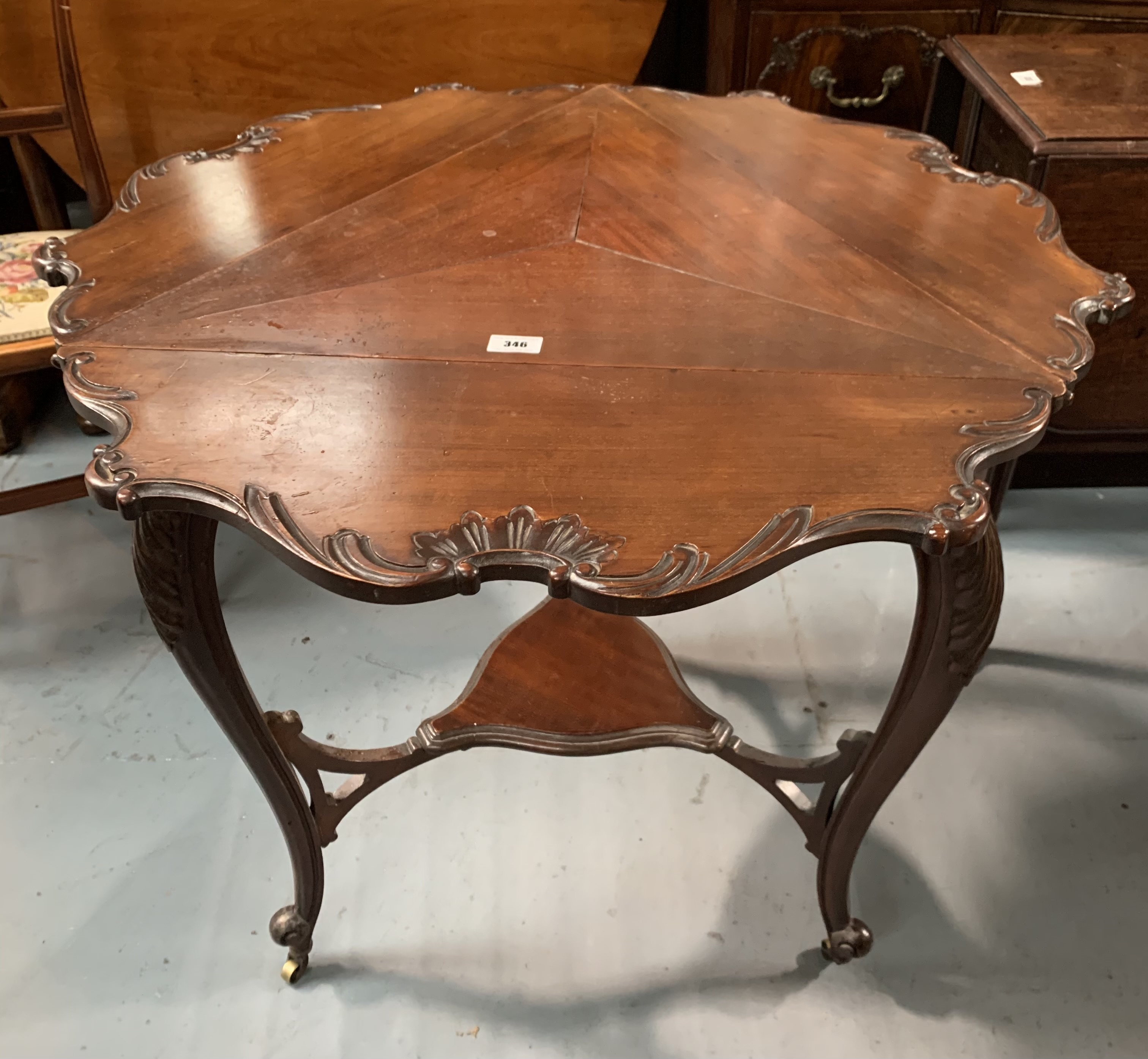 """Mahogany carved envelope table on castors. 25"""" per side closed, 31"""" open diameter, 29"""" high - Image 4 of 5"""