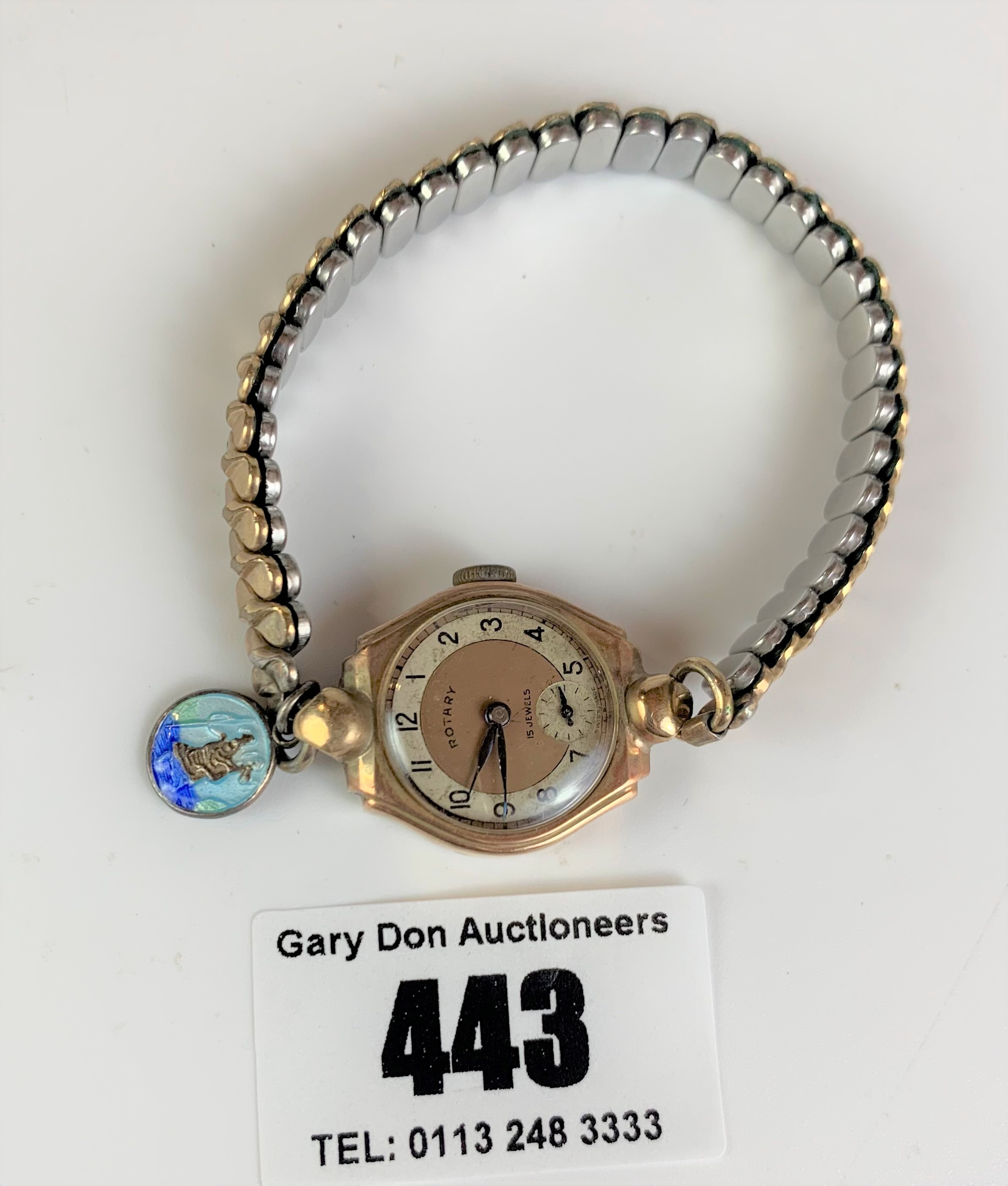 9k gold ladies Rotary watch with plated elasticated strap. Winder turns but not running