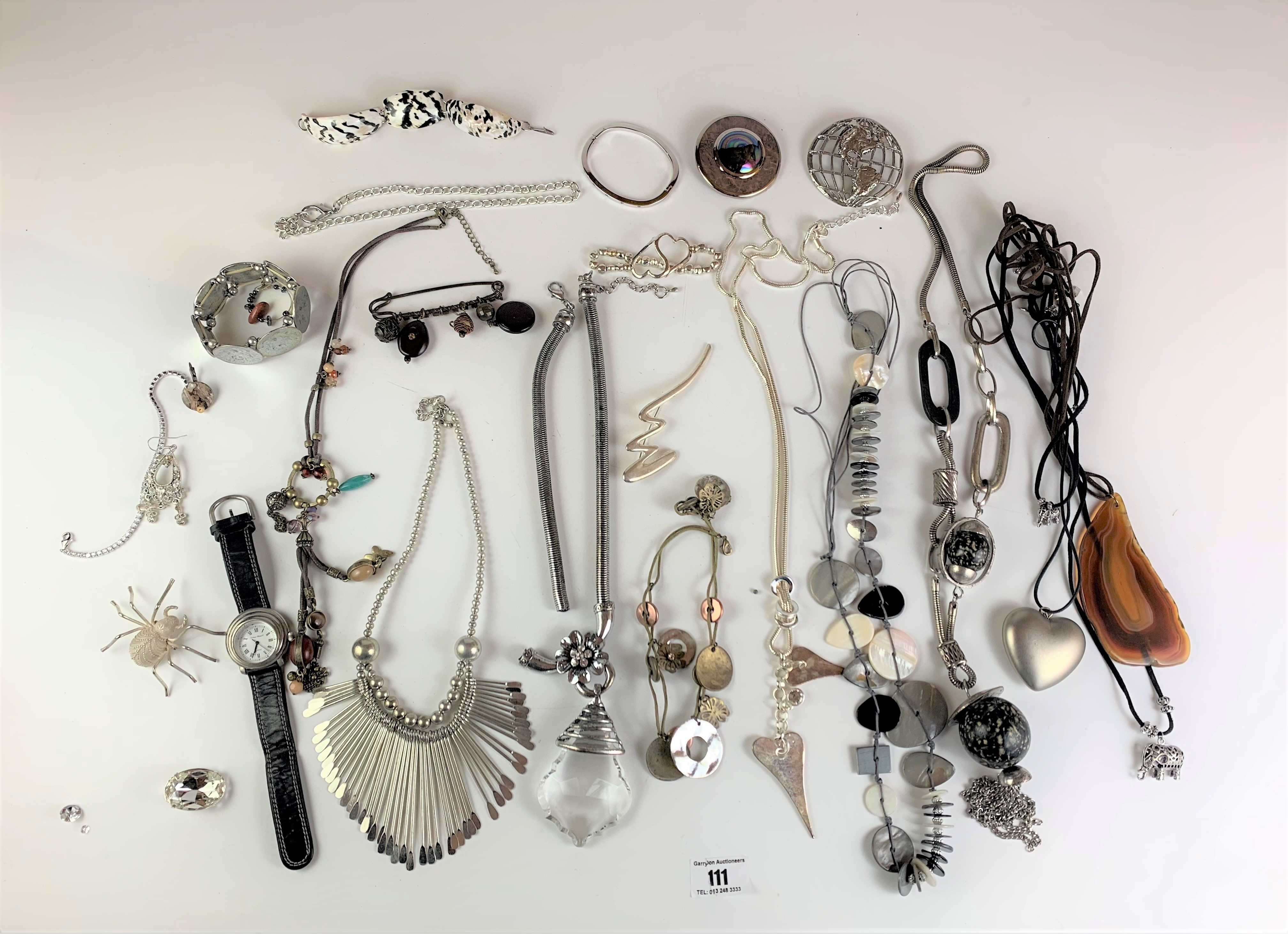 Large bag of assorted dress jewellery including necklaces, bracelets, watch, brooches etc.