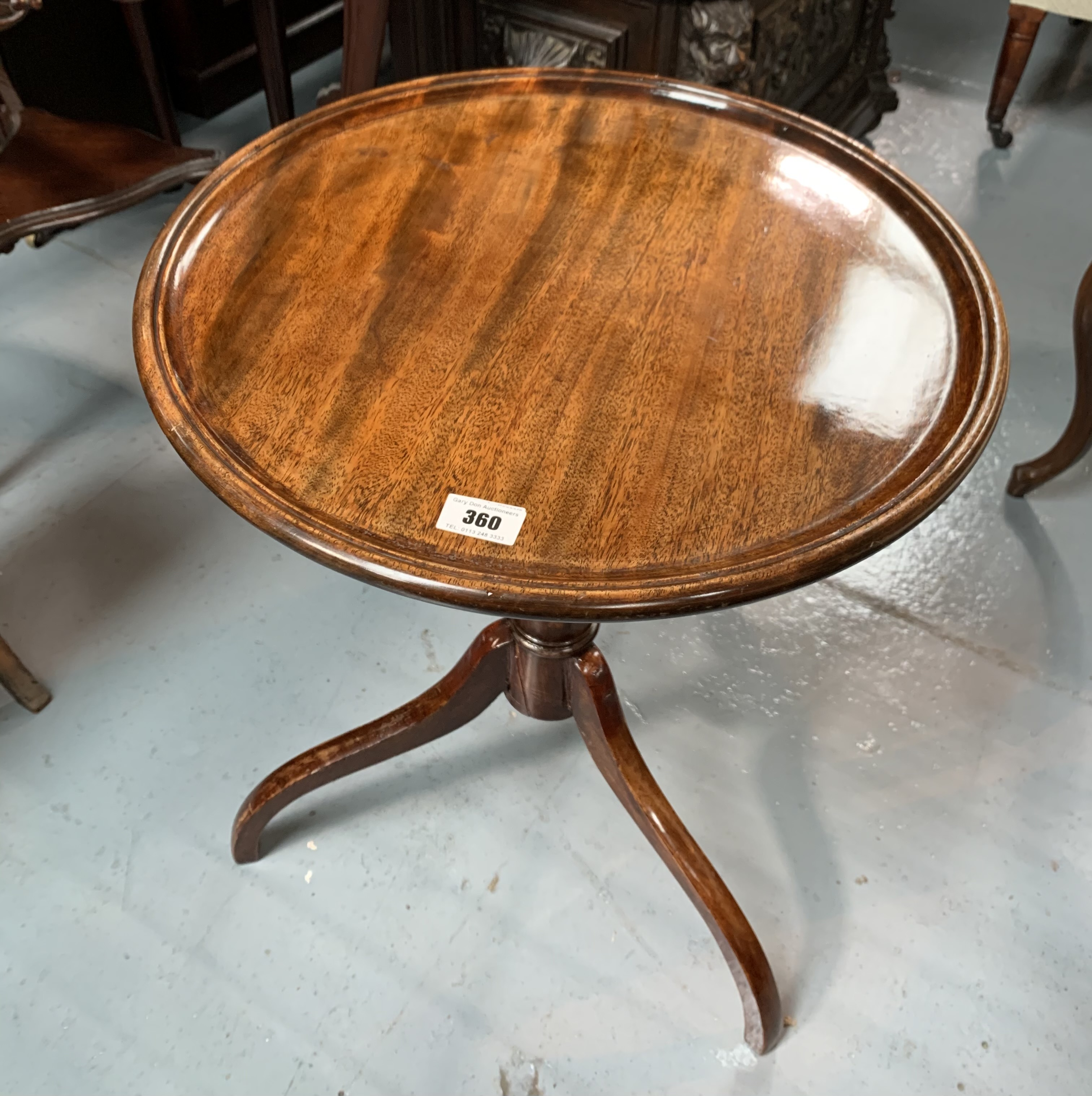 "Mahogany tripod table. 17.5"" diameter, 22"" high"