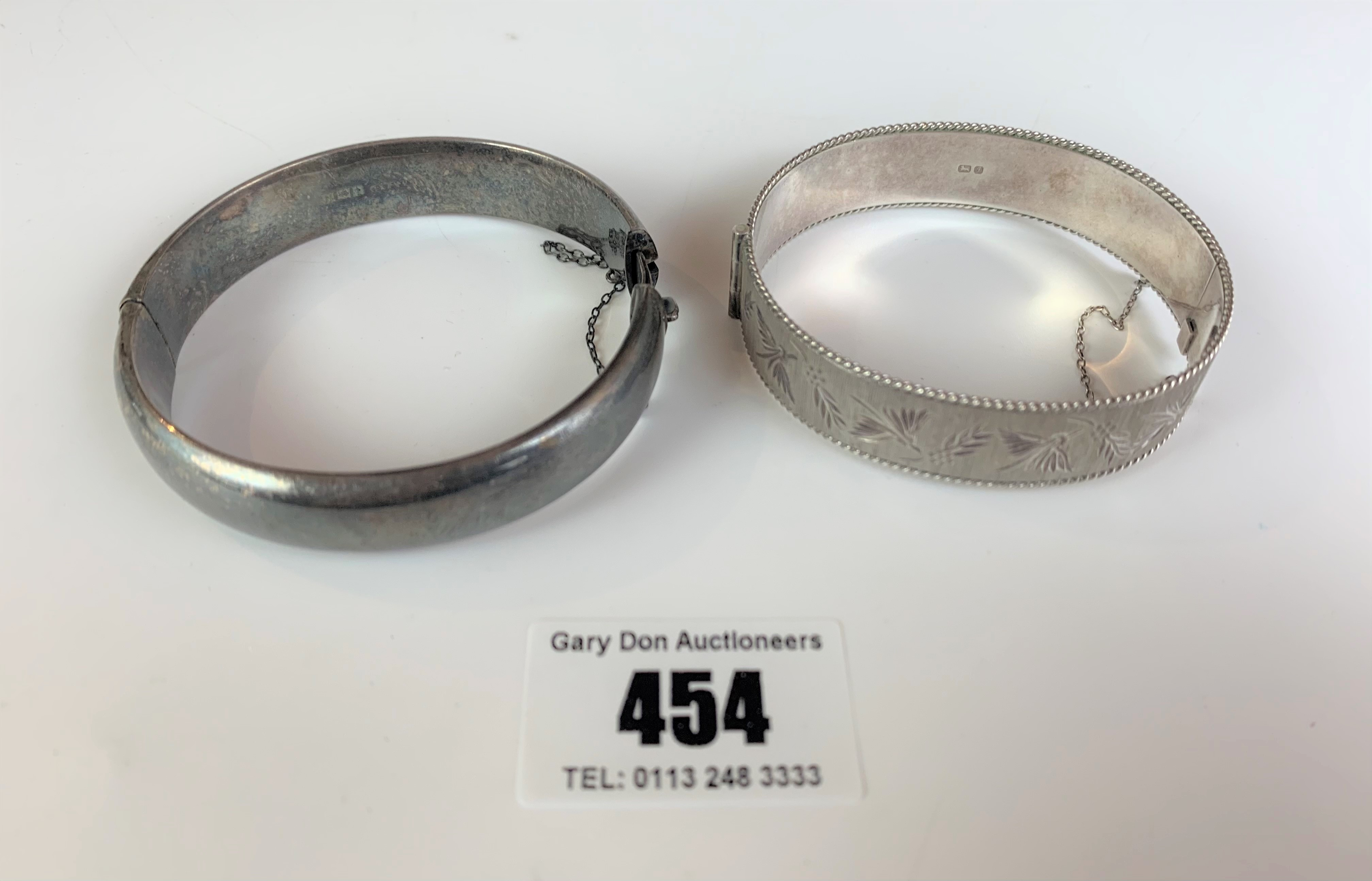 2 silver engraved bangles, total w: 1.5 ozt