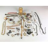 Large bag of assorted dress jewellery including necklaces, bracelets, brooches, earrings etc.