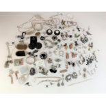 Large bag of assorted dress jewellery including necklaces, bracelets, earrings, brooches etc.