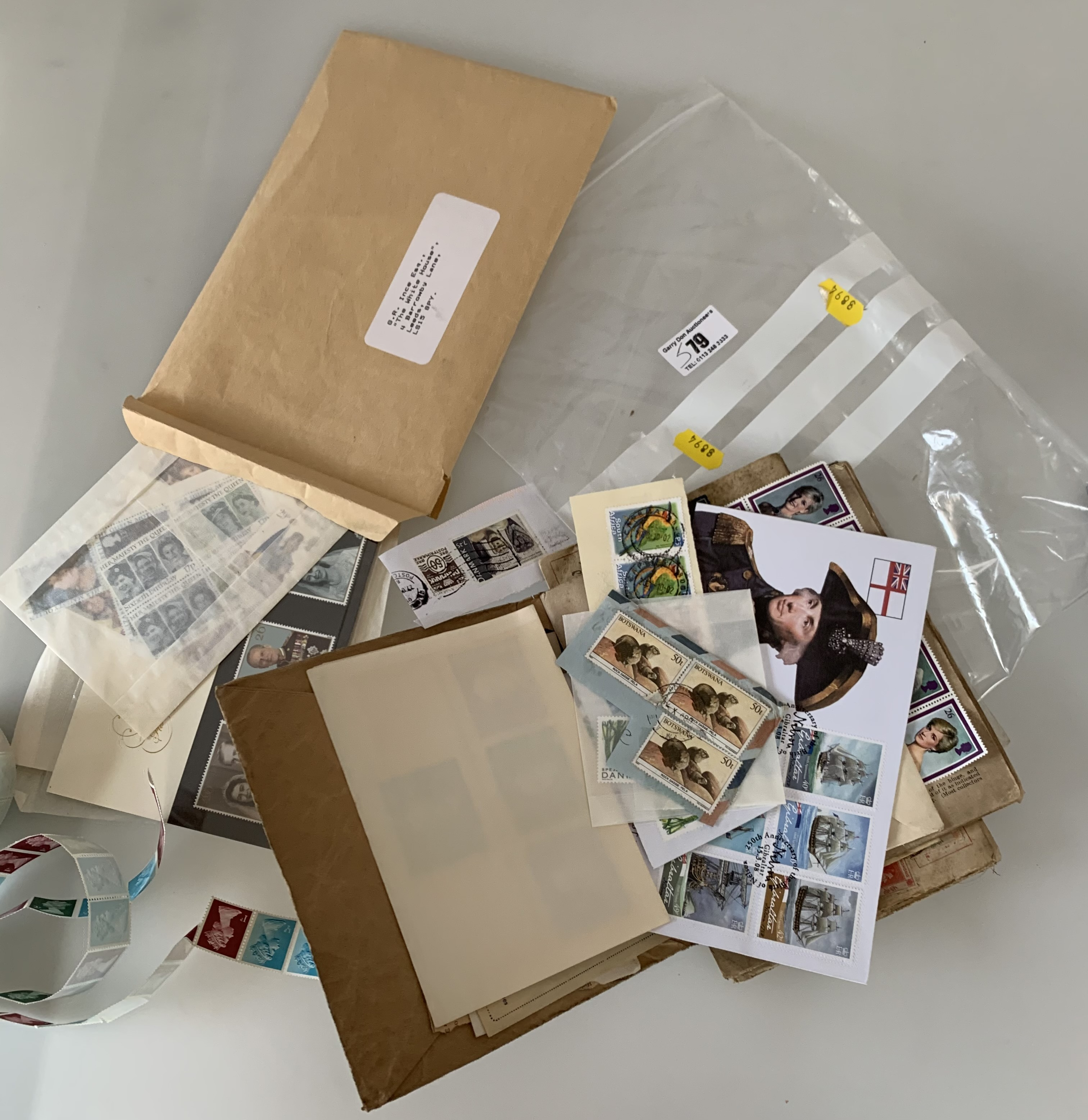 Roll of mint stamps and new and used stamps