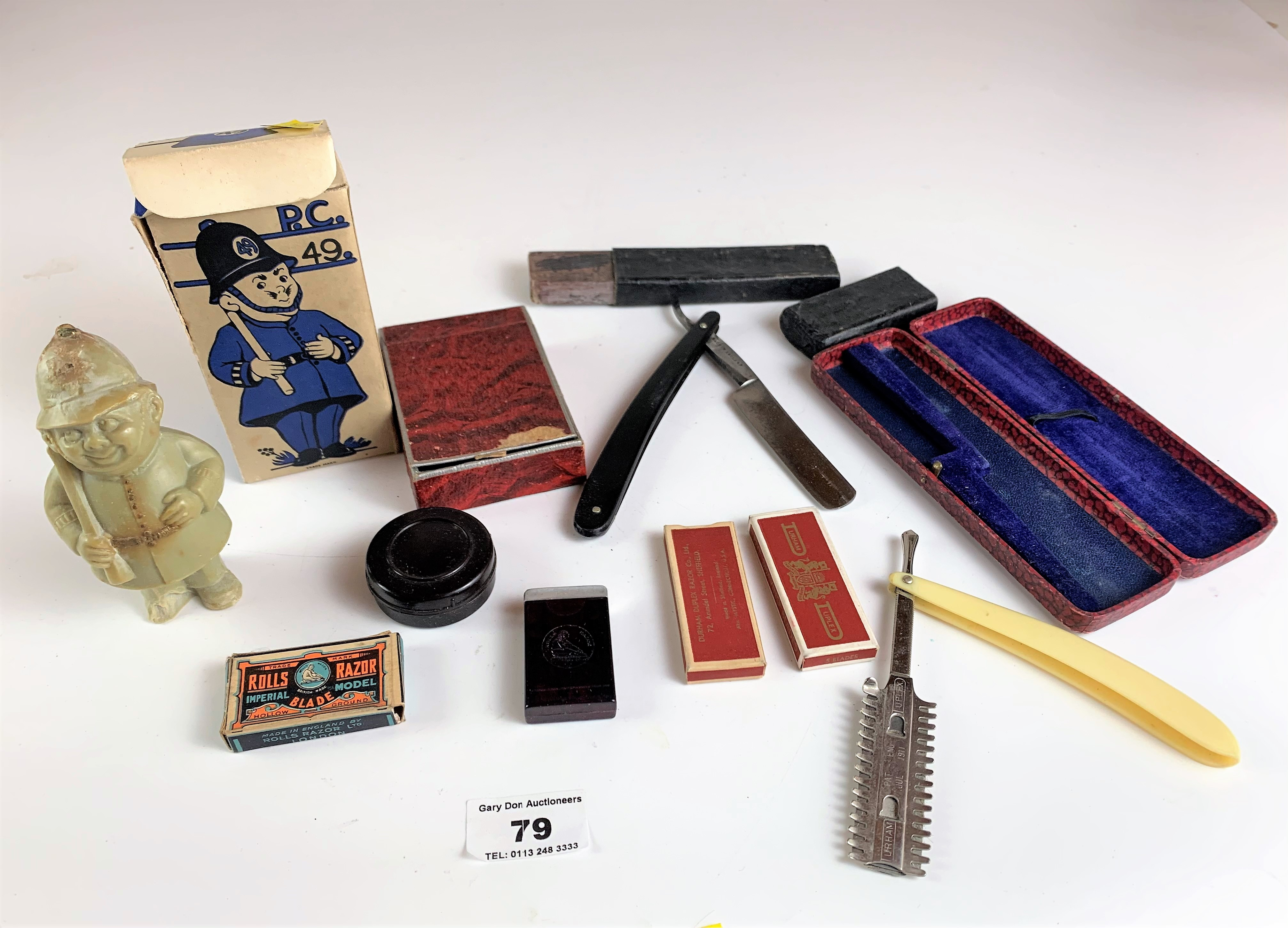 Assorted vintage razors and figure toilet soap