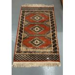 """Red patterned rug, 58"""" long, 36.5"""" wide. Worn"""