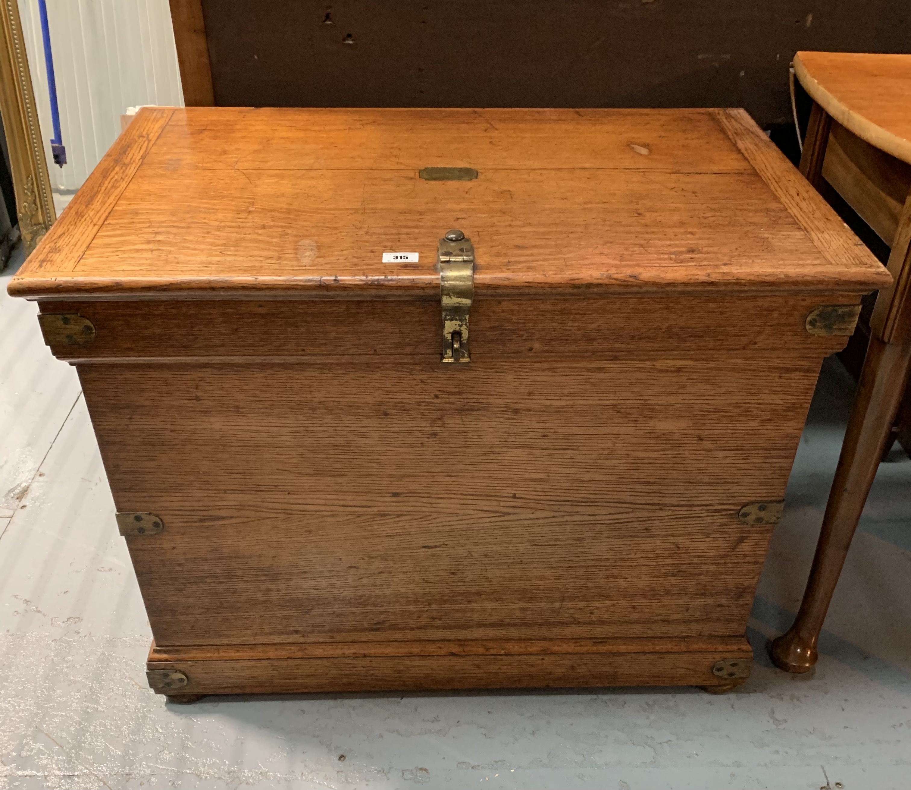"""Oak blanket box with brass hinges, lock, handles and plaque. 24"""" high, 32"""" wide, 20"""" deep"""