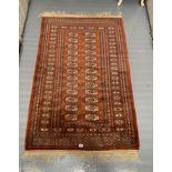 """Red patterned rug, 60"""" long, 39"""" wide"""