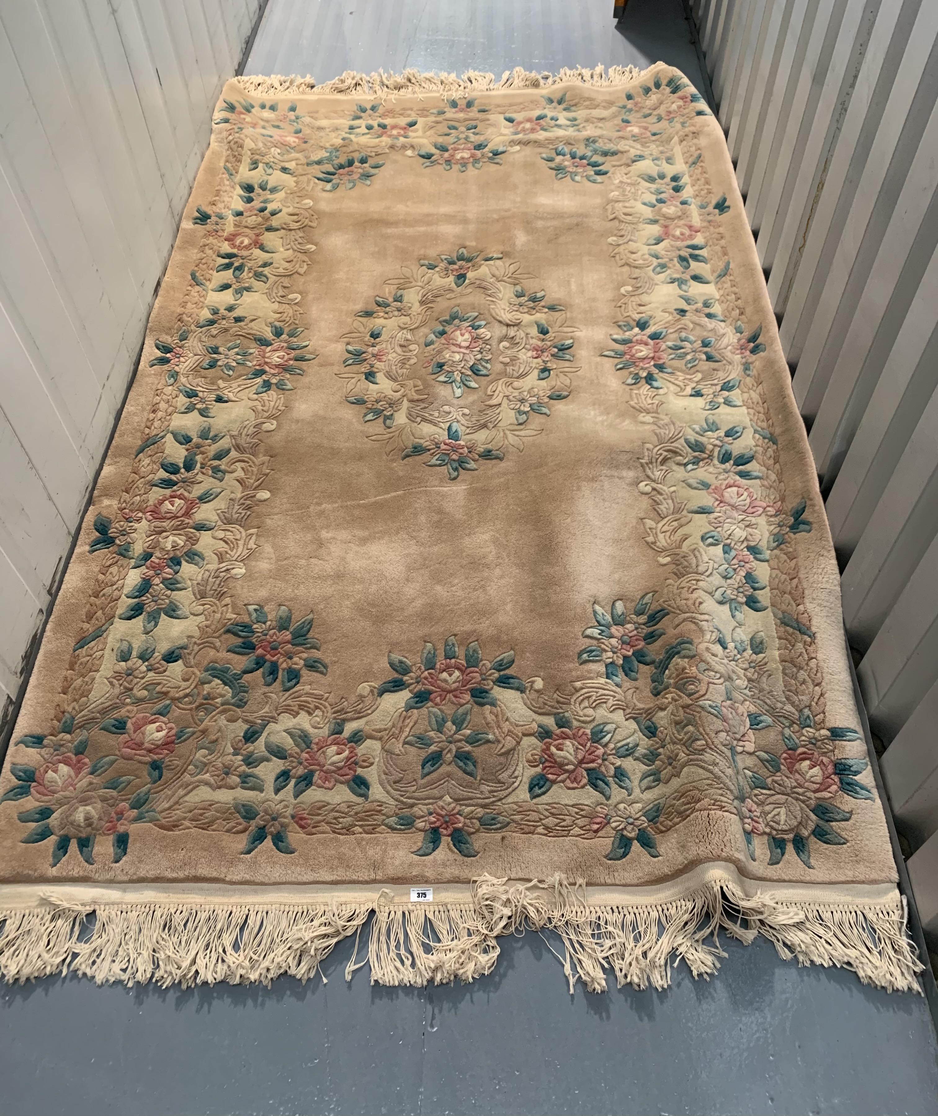"Pink/beige/green flowered rug, 96"" long, 60"" wide"