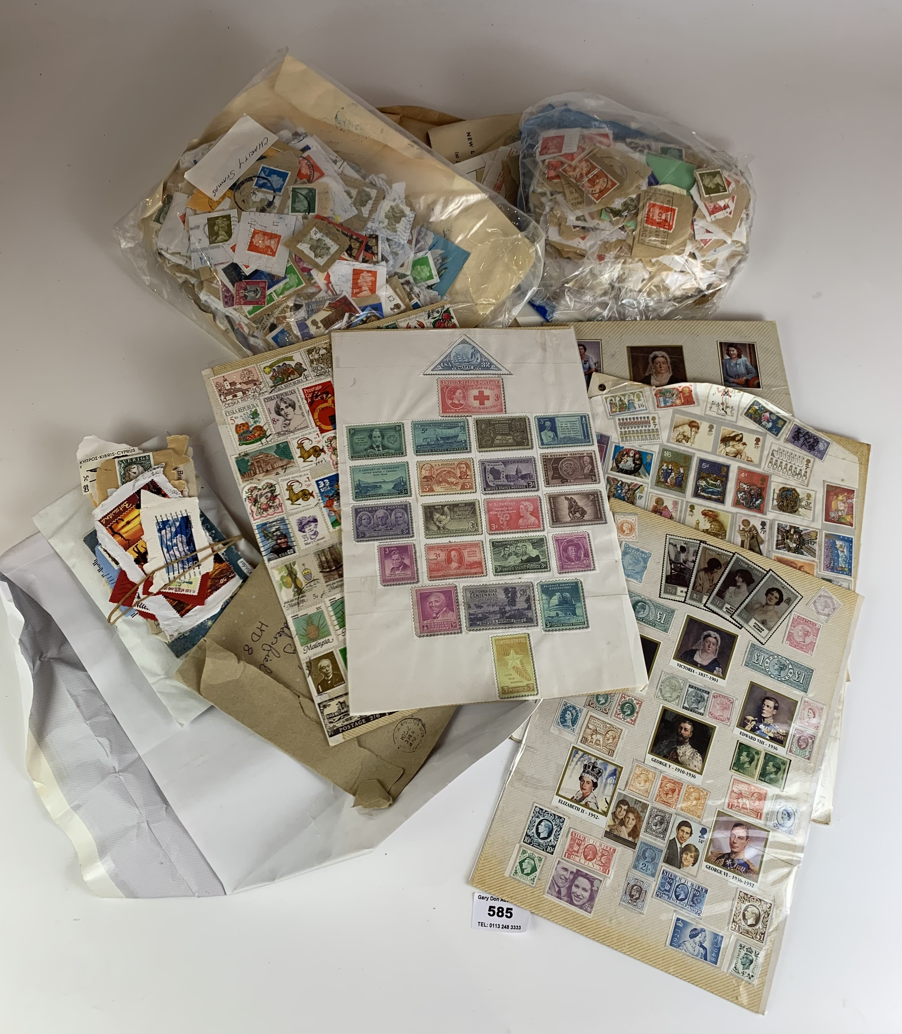 Bag of miscellaneous stamps on sheets and paper