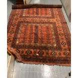 "Red geometric pattern rug, 107"" long, 74"" wide"