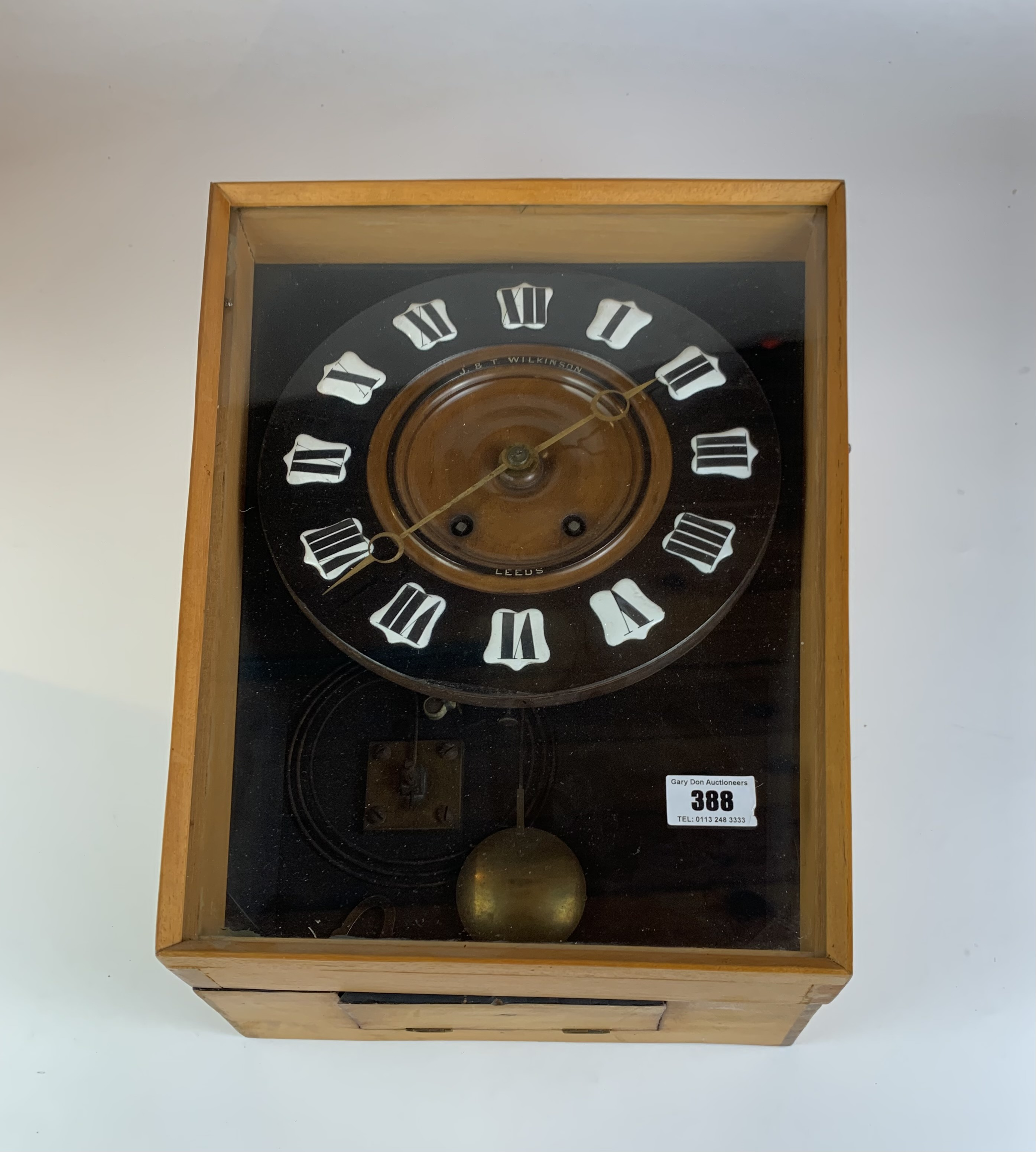 """Unusual wall clock by J & T Wilkinson, Leeds with pendulum and key, 15"""" high x 13"""" wide"""