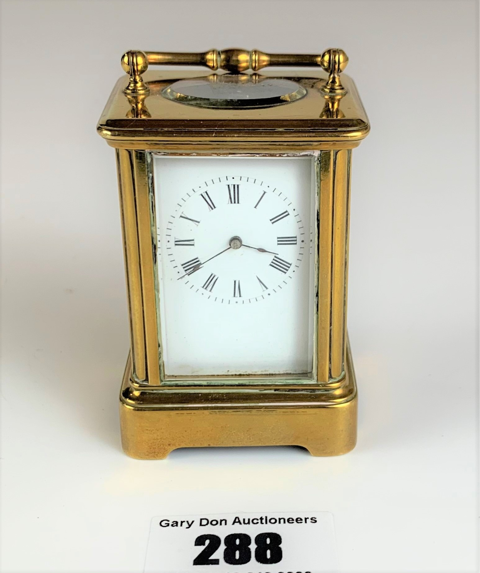 """Miniature brass carriage clock, 3"""" high plus handle. Working with key"""
