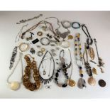 Large bag of assorted dress jewellery including necklaces, bracelets, earrings, rings etc.