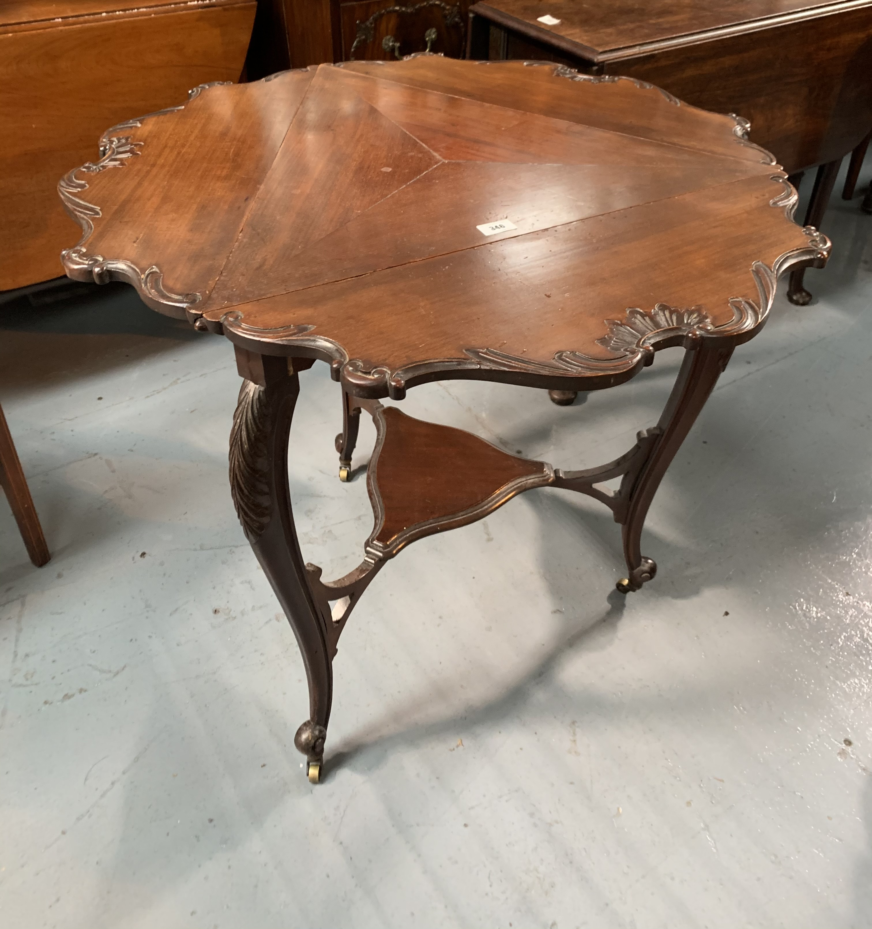 """Mahogany carved envelope table on castors. 25"""" per side closed, 31"""" open diameter, 29"""" high - Image 5 of 5"""