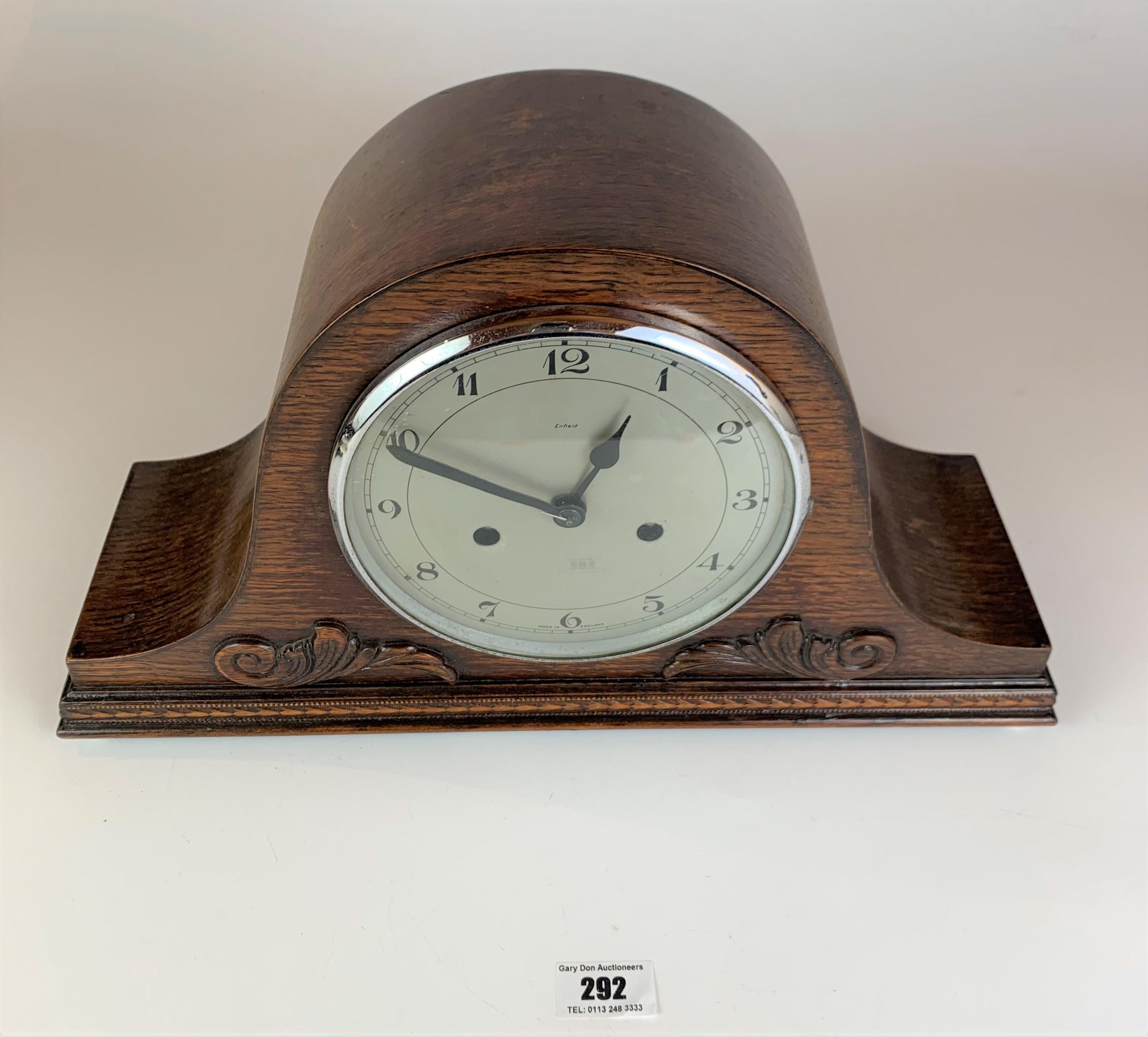 "Oak 2 hole mantle clock, 9"" high, 16"" wide. Working"