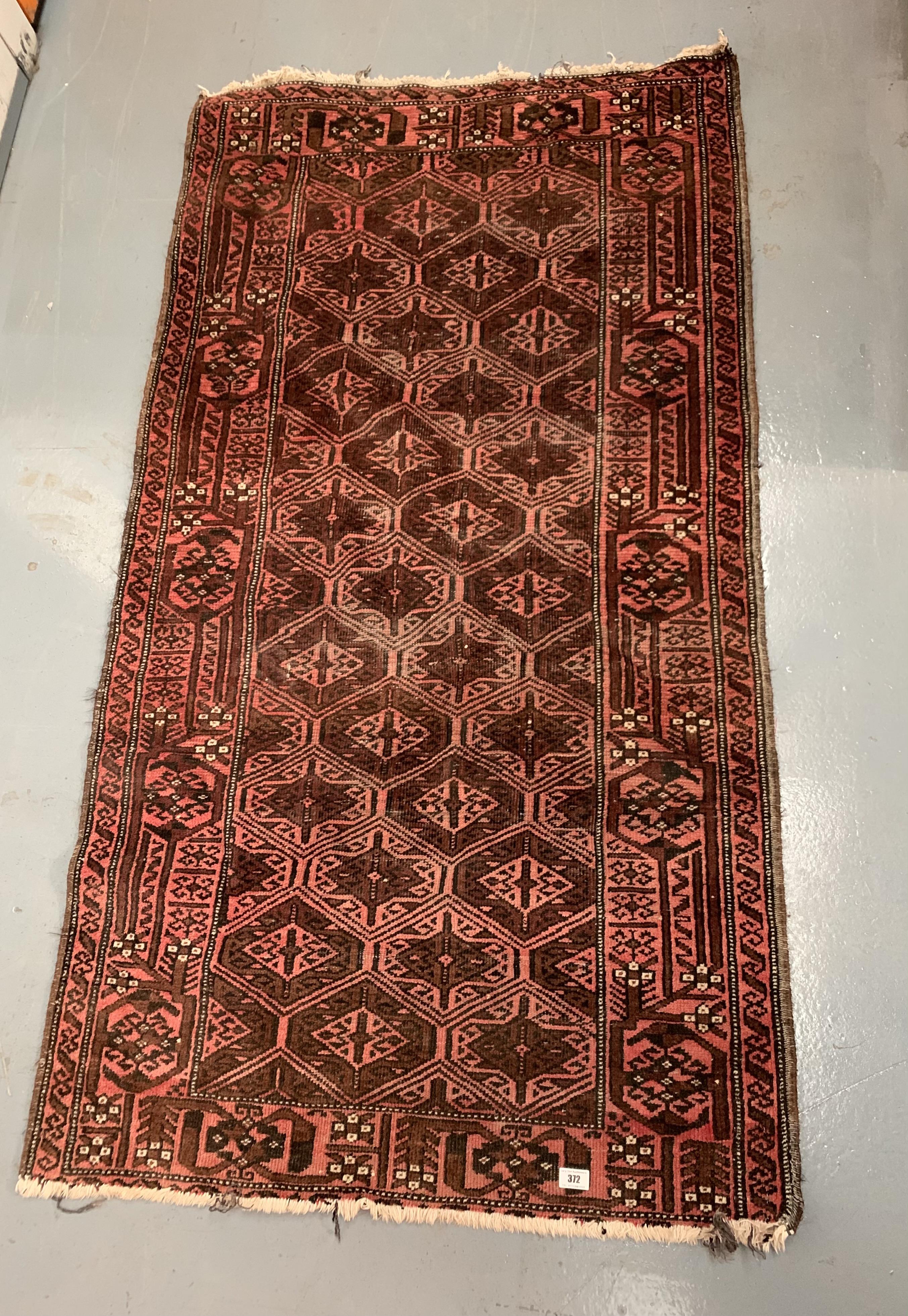 """Pink patterned rug, 67"""" long, 36"""" wide"""