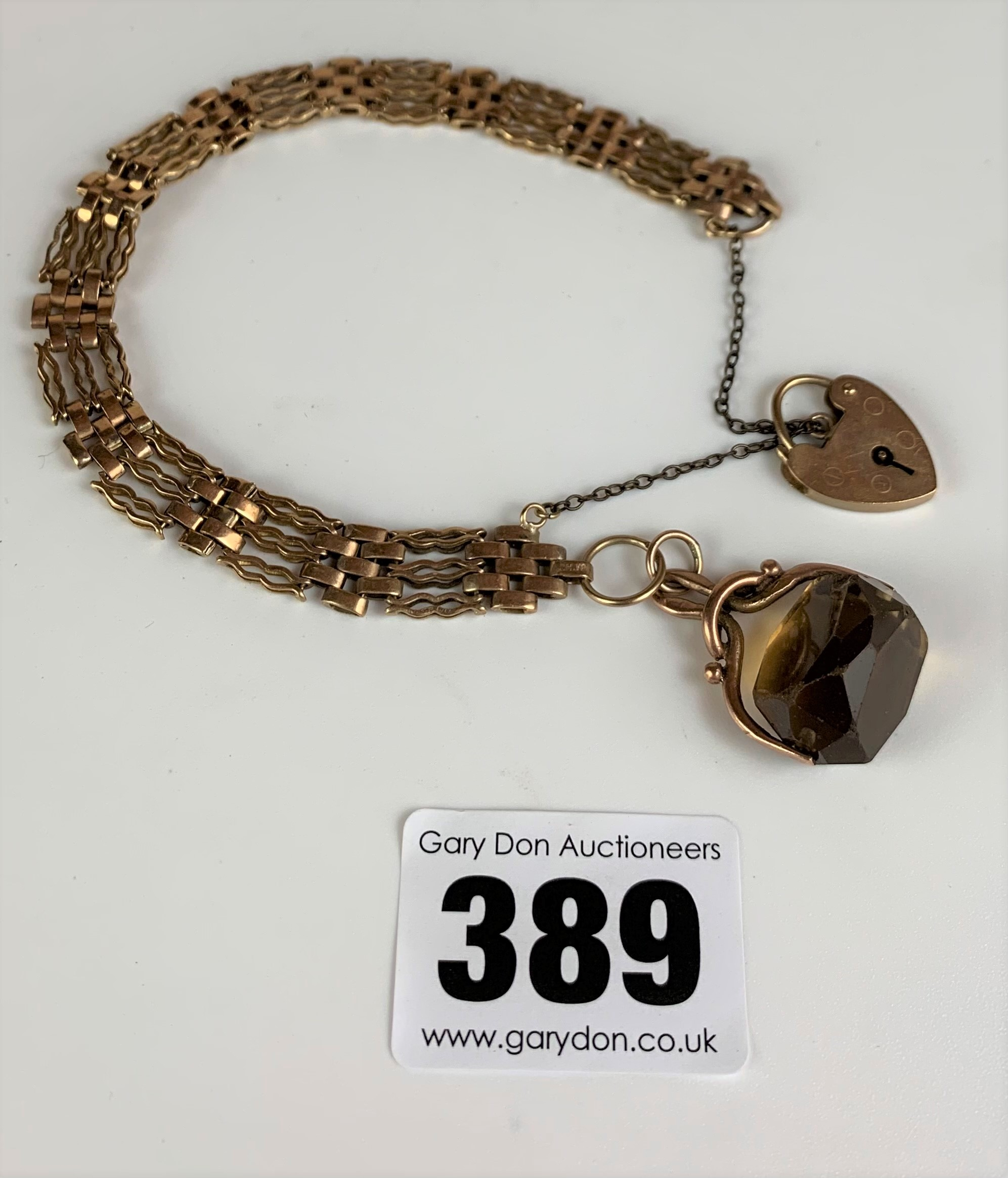 """9k gold gate bracelet, length 8"""", with heart lock and yellow stone swivel fob, total w: 14 gms - Image 2 of 3"""