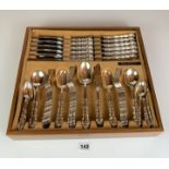 Cutlery drawer containing full set of 64 pieces of Community stainless steel cutlery