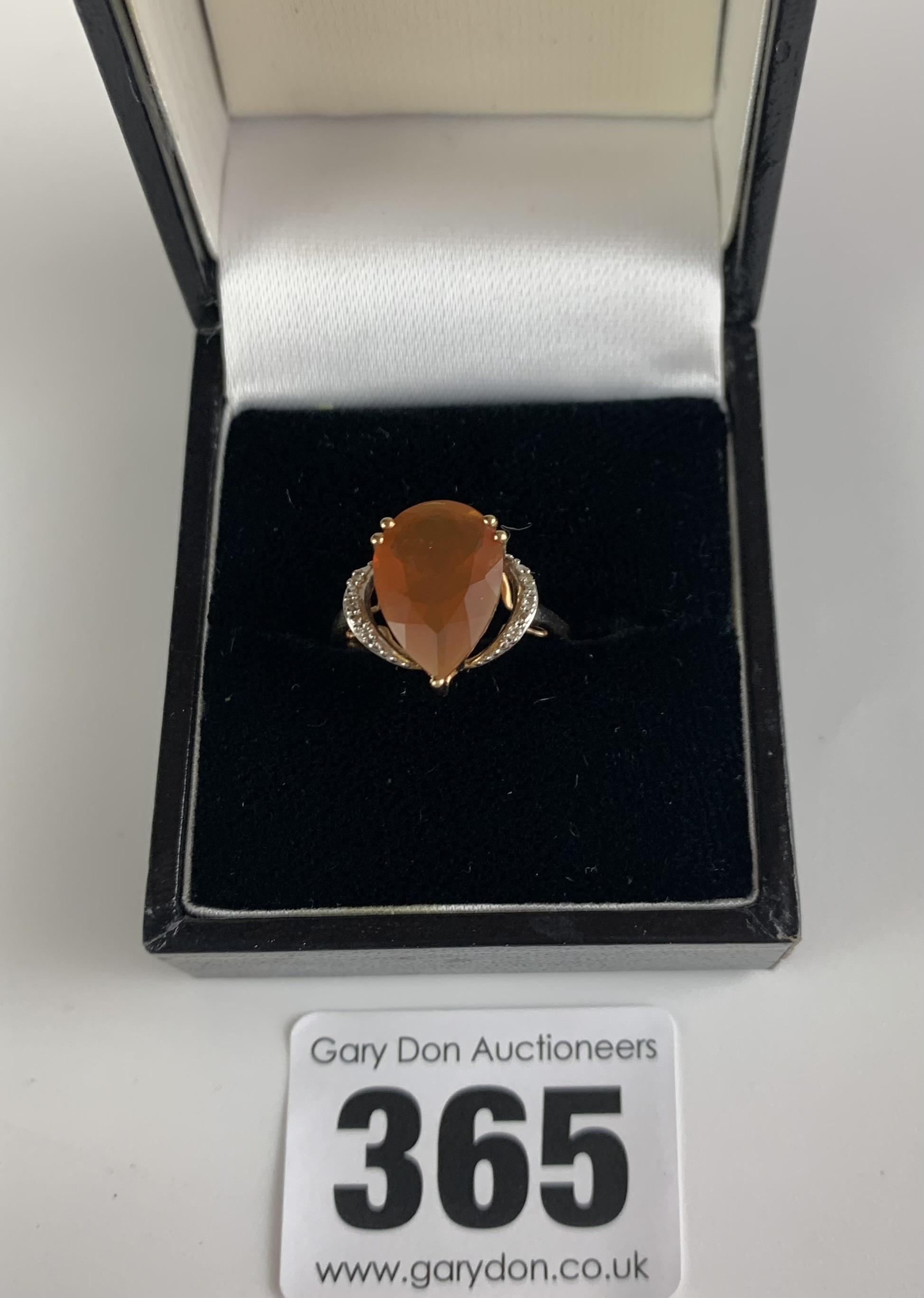 10k gold ring with heart shaped orange stone, size J/K, w: 2.1 gms