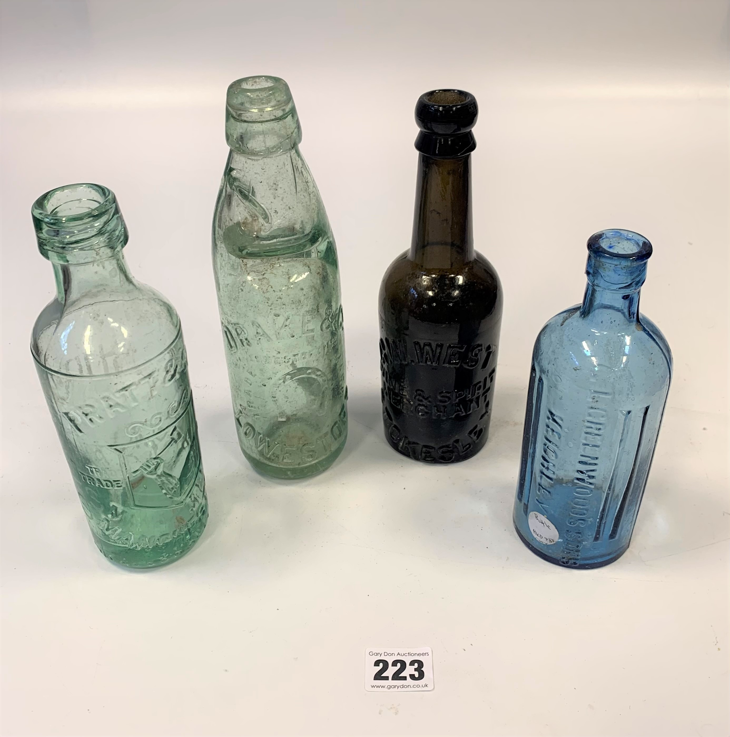 2 blue glass rolling pins and 4 old glass bottles - Image 4 of 5