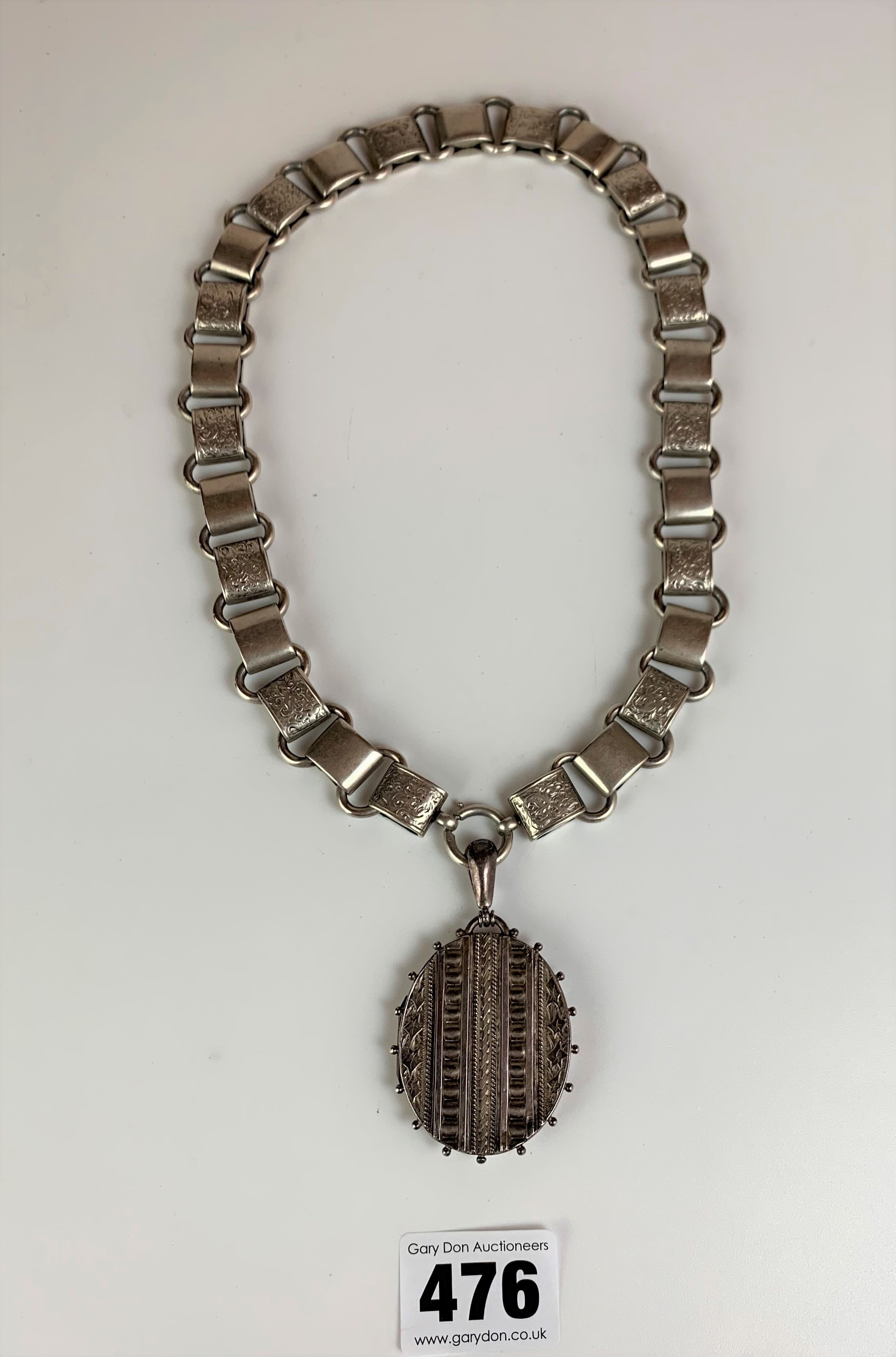 """Silver chain with silver locket, chain 18"""", locket 2"""". Total w: 2.3 ozt"""