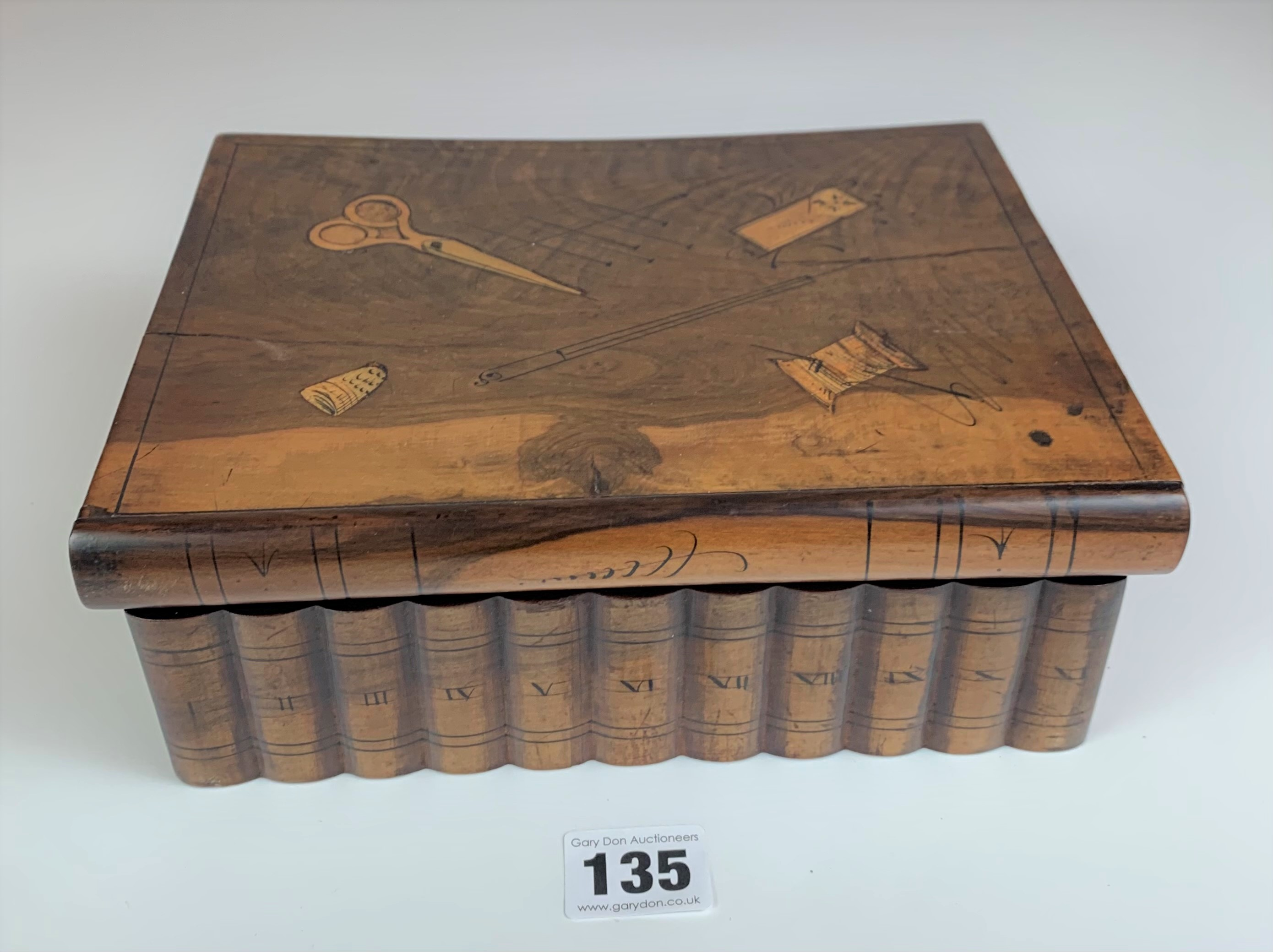 "Walnut book shaped sewing box. 9"" long x 7"" wide x 3"" high"