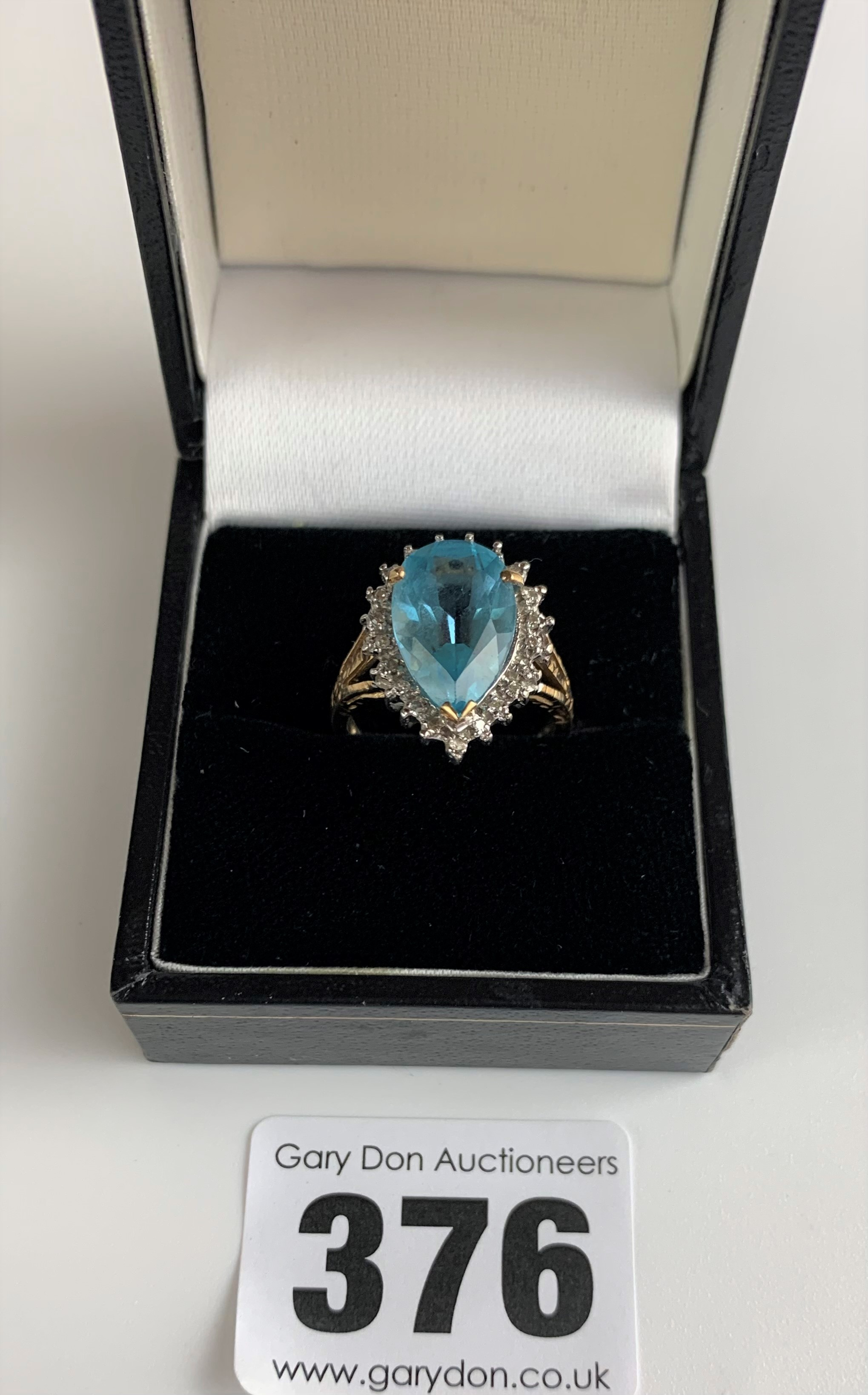 9k gold ring with blue heart shaped stone, size L, w: 3.5 gms