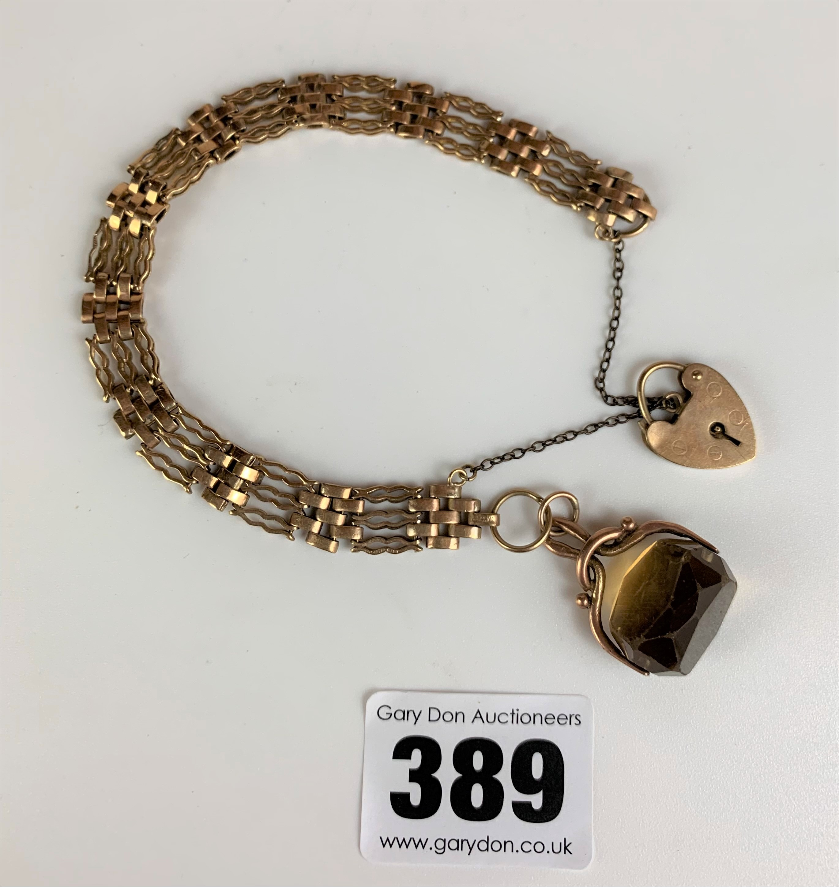 """9k gold gate bracelet, length 8"""", with heart lock and yellow stone swivel fob, total w: 14 gms"""