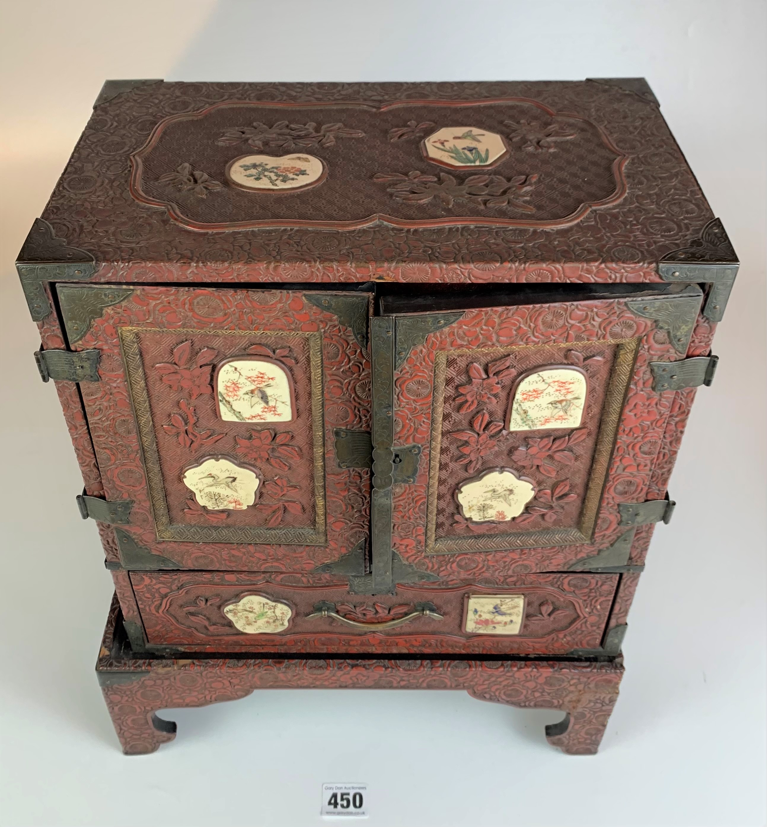 Small Japanese carved red cinnabar lacquer table cabinet with 8 Satsuma plaques on a matching stand. - Image 2 of 11
