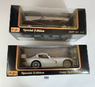 2 boxed Maisto Special Edition 1:18 die cast cars – Dodge Viper GTS-R and BMW 502