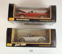 2 boxed Maisto Special Edition 1:18 cars – 1999 Mustang GT and Porsche Boxster