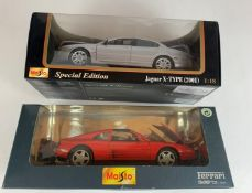2 boxed Maisto Special Edition 1:18 die cast cars – Jaguar X-Type 2001 and Ferrari 348ts 1990