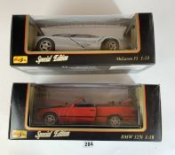 2 boxed Maisto Special Edition 1:18 die cast cars – McLaren F1 and BMW 325i