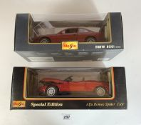 2 boxed Maisto Special Edition 1:18 die cast cars – Alfa Romeo Spider and BMW 850i 1990