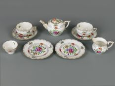 Herend porcelain tea for two, decorated with sprays of flowers within foliate borders, heightened in