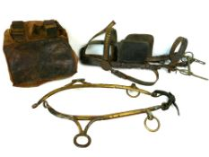 "Antique leather and brass horse harness; together with a pair of 21"" antique brass hames and a"