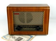 1950s PYE model P75 walnut veneered cased radio, with original guarantee and instruction papers, 16""