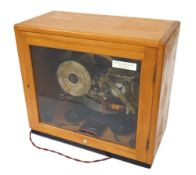 """Gents of Leicester C69 programmer with bells and lights, within a light wooden glazed case, 16"""""""
