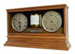 """Good large weather station, comprising twin drumhead cased clock and barometer movements with 7"""""""