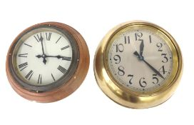 """Magneta 7"""" slave dial with one-minute alternating polarity, within a turned waxed mahogany surround;"""