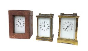 """Brass carriage clock timepiece, 5.75"""" high (key), with outer Morocco travelling case; also two other"""