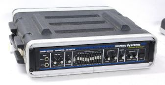 Hartke Systems Transient Attack Model HA7000 bass guitar amplifier rack within a rack flight case