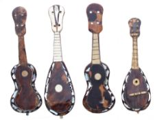 Two miniature tortoiseshell and mother of pearl inlaid Neapolitan mandolins; also two similar